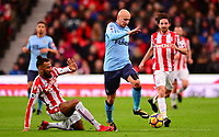 Maxim Choupo of Stoke makes a slide tackle on Jonjo Shelvey of Newcastle during the EPL - Premier League match between Stoke City and Newcastle United at the Britannia Stadium, Stoke-on-Trent, England on 1 January 2018. Photo by Bradley Collyer / PRiME Media Images.