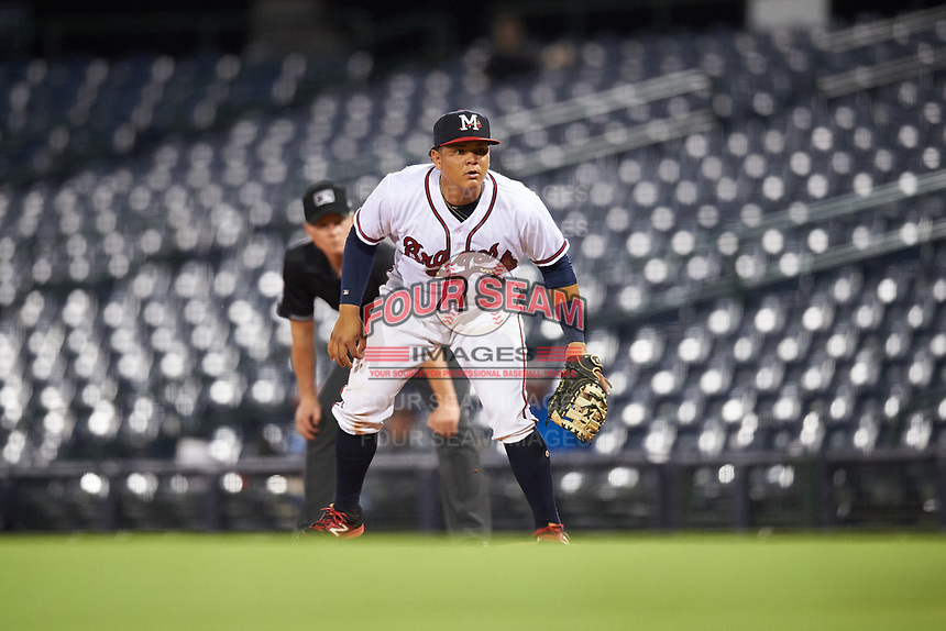 Mississippi Braves first baseman Jonathan Morales (9) in front of first base umpire Brandon Butler during a game against the Mobile BayBears on May 7, 2018 at Trustmark park in Pearl, Mississippi.  Mobile defeated Mississippi 5-0.  (Mike Janes/Four Seam Images)