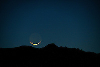 thin crescent moonrise