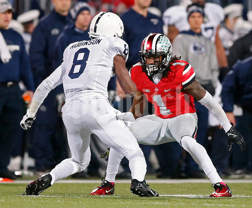 Ohio State Buckeyes cornerback Bradley Roby (1) takes on Penn State Nittany Lions wide receiver Allen Robinson (8) in the 2nd quarter at Ohio Stadium on October 26, 2013.  (Dispatch photo by Kyle Robertson)