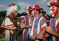 Jul 9, 2006; Berlin, GERMANY; An Italy supporter greets several France supporters outside the Olympiastadion prior to the match between Italy and France in the final of the 2006 FIFA World Cup. Mandatory Credit: Ron Scheffler-US PRESSWIRE Copyright © Ron Scheffler