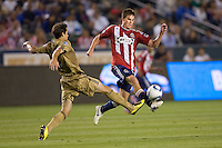 Philadelphia Union midfielder Stefani Miglioranzi (6) defends against advancing CD Chivas USA forward Justin Braun (17). The Philadelphia Union and CD Chivas USA played to 1-1 draw at Home Depot Center stadium in Carson, California on Saturday evening July 3, 2010..