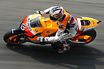 KUALA LUMPUR, MALAYSIA - OCTOBER 24:  Andrea Dovizioso of Italy rides the #4 Repsol Honda Team Honda during free practice for the Malaysian MotoGP, which is round 16 of the MotoGP World Championship at the Sepang Circuit on October 24, 2009 in Kuala Lumpur, Malaysia. Photo by Victor Fraile / The Power of Sport Images