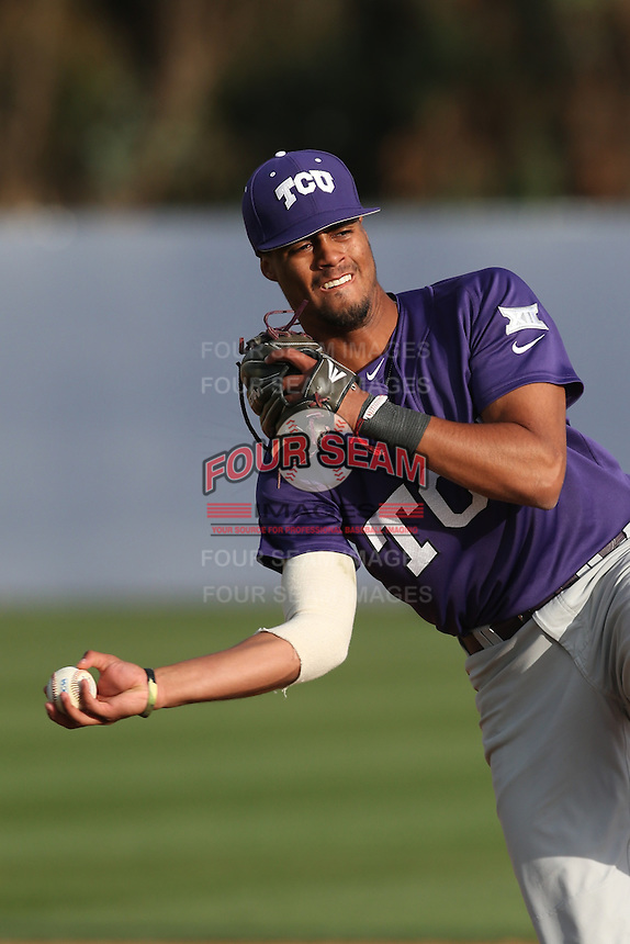 Michael Landestoy (7) of the TCU Horned Frogs makes a throw before a game against the Loyola Marymount Lions at Page Stadium on March 16, 2015 in Los Angeles, California. TCU defeated Loyola, 6-2. (Larry Goren/Four Seam Images)