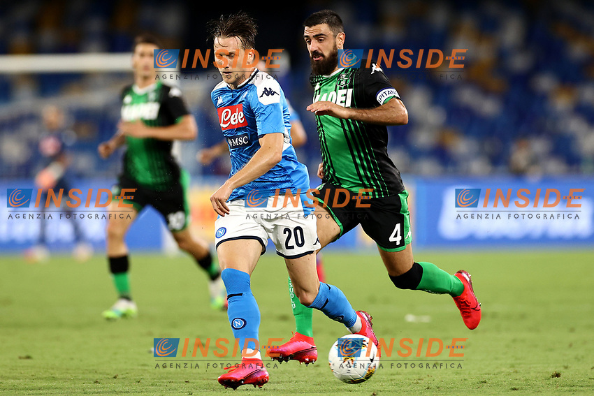 Piotr Zielinski of SSC Napoli and Francesco Magnanelli of US Sassuolo compete for the ball during the Serie A football match between SSC Napoli and US Sassuolo at stadio San Paolo in Napoli ( Italy ), July 25th, 2020. Play resumes behind closed doors following the outbreak of the coronavirus disease. <br /> Photo Cesare Purini / Insidefoto