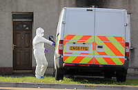 Pictured: A police forensics officer outside the house where the body of Alison Jane Farr-Davies was discovered in Swanse, Wales, UK Wednesday 14 September 2016<br /> Re: A man has been arrested on suspicion of murder following the death of a woman in the Hafod area of Swansea.<br /> The body of 42 year old Alison Jane Farr-Davies was found dead at a home in Neath Road, at about 13:35 on Tuesday.<br /> Police said officers responded to several calls from residents who reported seeing a man in the road between 13:00 and 14:00, and appealed for witnesses to come forward.<br /> The arrested man, 37, remains in custody at Swansea Central station.<br /> Acting Det Supt Kath Pritchard thanked people who stopped at the scene to help on Tuesday.