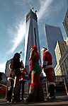 People dressed as santa claus pauses in front the World Trade center while they take part during the SantaCon party in New York, United States. 15/12/2012. Photo by Kena Betancur/VIEWpress.