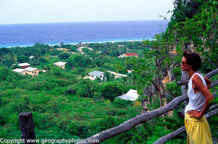 Woman tourist looks over Spot Bay, Cayman Brac, Cayman Islands, British West Indies,