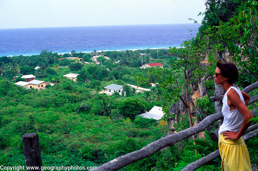 Woman tourist looks over Spot Bay, Cayman Brac, Cayman Islands, British West Indies,