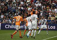 CARSON, CA - DECEMBER 01, 2012:   Omar Gonzalez (4) of the Los Angeles Galaxy leaps over the defense of the Houston Dynamo to score the first Galaxy goal during the 2012 MLS Cup at the Home Depot Center, in Carson, California on December 01, 2012. The Galaxy won 3-1.