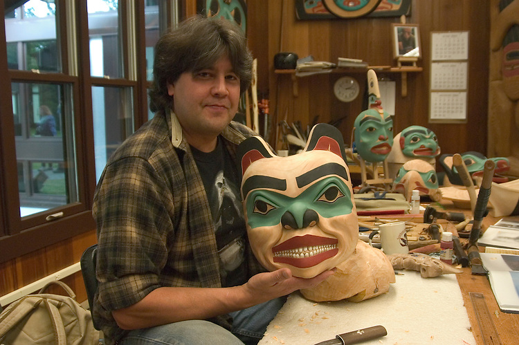 Alaska, Sitka..Master Tlingit carver Tommy Joseph and his carvings, Model Released, at the Sitka National Historic site..Photo copyright Lee Foster, 510/549-2202, lee@fostertravel.com, www.fostertravel.com..