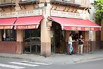 Men standing outside local cafe bar, Bario Macerana, city centre of Seville, Spain