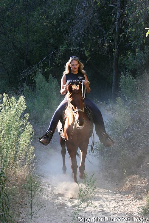 Woman on horseback in Monterey Co.