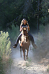 Woman on horseback in Monterey Co.