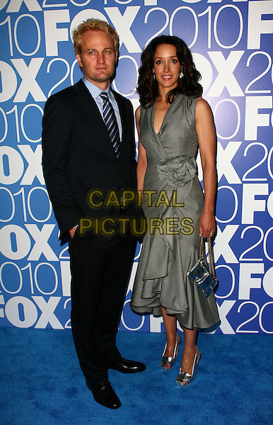JASON CLARKE & JENNIFER BEALS .The 2010 FOX Upfront after party at Wollman Rink, Central Park, New York City, NY, USA..May 17th, 2010.full length black suit dress grey gray wrap corsage.CAP/ADM/PZ.©Paul Zimmerman/AdMedia/Capital Pictures.