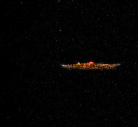 """The Carrier"":  looking like an aircraft carrier, this UFO/alien craft was HUGE.  Sighted in the SW skies over Elliott Bay, Seattle."