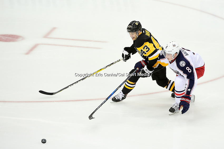 Wednesday, April 12, 2017: Pittsburgh Penguins left wing Conor Sheary (43) and Columbus Blue Jackets defenseman Zach Werenski (8) battle for the puck during game 1 of round one of the National Hockey League Eastern Conference Stanley Cup Playoffs between the Columbus Blue Jackets and the Pittsburgh Penguins, held at PPG Paints Arena, in Pittsburgh, PA.  Pittsburgh defeats Columbus 3-1. Eric Canha/CSM