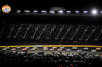 Oct. 17, 2009; Concord, NC, USA; NASCAR Sprint Cup Series drivers head past the turn two grandstands during the NASCAR Banking 500 at Lowes Motor Speedway. Mandatory Credit: Mark J. Rebilas-