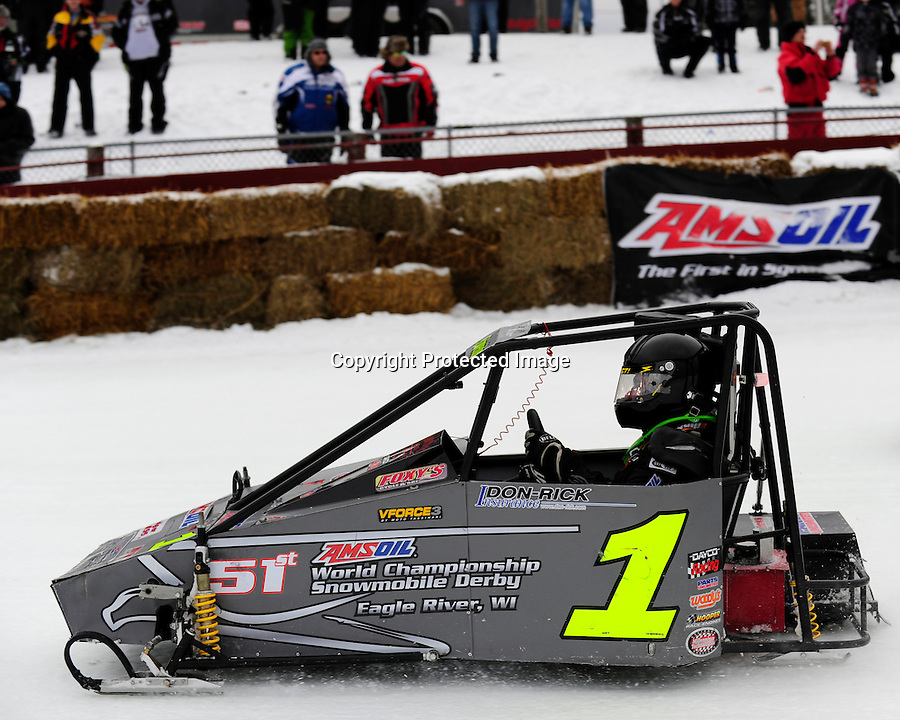 Joe Schneider of St. Germain, WI races his Outlaw 600 class snowmobile at the AMSOIL World Championship Snowmobile Derby in Eagle River, WI, Jan. 19, 2014.