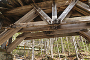 Built in the early 1900s, Trestle No. 16 crosses Black Brook along the old East Branch & Lincoln Railroad (1893-1948) in the Pemigewasset Wilderness of Lincoln, New Hampshire. This photo shows how the trestle looked in May 2009. In 2010, Forest Service dismantled the steel footbridge in the background, and it was not replaced.