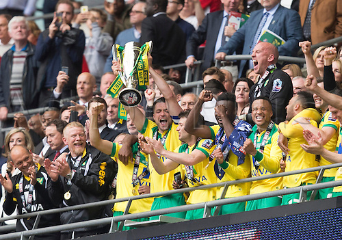 25.05.2015.  London, England. Skybet Championship Playoff Final. Middlesborough versus Norwich. Norwich City's Russell Martin lifts the trophy at the final whistle.