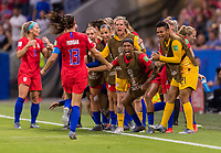 LYON,  - JULY 2: Alex Morgan #13 celebrates with Ashlyn Harris #18 and Jess McDonald #22 and other teammates during a game between England and USWNT at Stade de Lyon on July 2, 2019 in Lyon, France.
