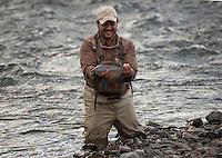 150620-JRE-7981E-0185 Cal Trout, a teacher and quail hunting guide from Mississippi, admires a trophy-sized Arctic Grayling he caught on an interior Alaska stream.