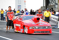 Jun. 1, 2012; Englishtown, NJ, USA: Crew members stand alongside the car of NHRA pro stock driver Grace Howell during qualifying for the Supernationals at Raceway Park. Mandatory Credit: Mark J. Rebilas-