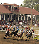 Horses round a corner past the grandstand during the third race of the day at the Three County Fair in Northampton on Friday, August 29, 2003. Photo by Christopher Evans