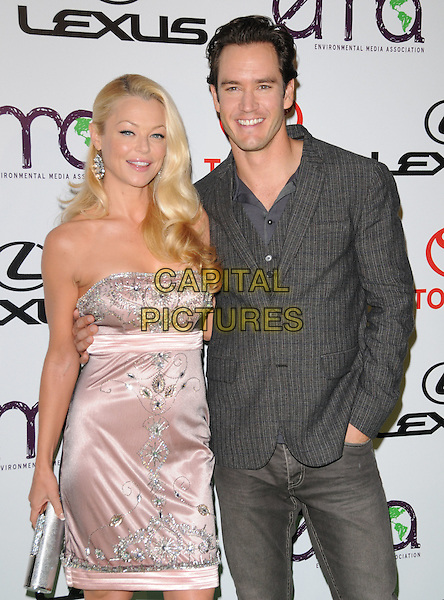 CHARLOTTE ROSS & MARK-PAUL GOSSELAAR .at The 2010 Environmental Media Association Awards held at WB Studios in Burbank, California, USA, .October 16th 2010..emas ema half length strapless pink dress grey gray suit  beaded clutch bag silver                                                           .CAP/RKE/DVS.©DVS/RockinExposures/Capital Pictures.