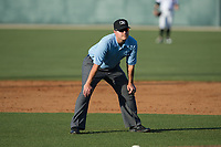 Umpire Mike Rains handles the calls on the bases during the South Atlantic League game between the Lakewood BlueClaws and the Kannapolis Intimidators at Kannapolis Intimidators Stadium on April 9, 2017 in Kannapolis, North Carolina.  The BlueClaws defeated the Intimidators 7-1.  (Brian Westerholt/Four Seam Images)
