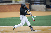 Joey Rodriguez (8) of the Wake Forest Demon Deacons makes contact with the baseball against the Towson Tigers at Wake Forest Baseball Park on March 1, 2015 in Winston-Salem, North Carolina.  The Demon Deacons defeated the Tigers 15-8.  (Brian Westerholt/Four Seam Images)