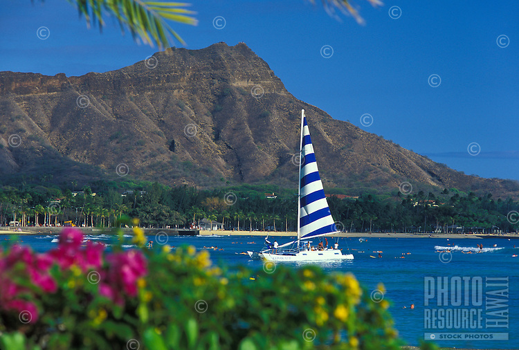Diamond Head at Waikiki beach with sailboat, Island of Oahu