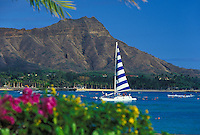 Diamond Head at Waikiki beach with sailboat, Island of Oahu