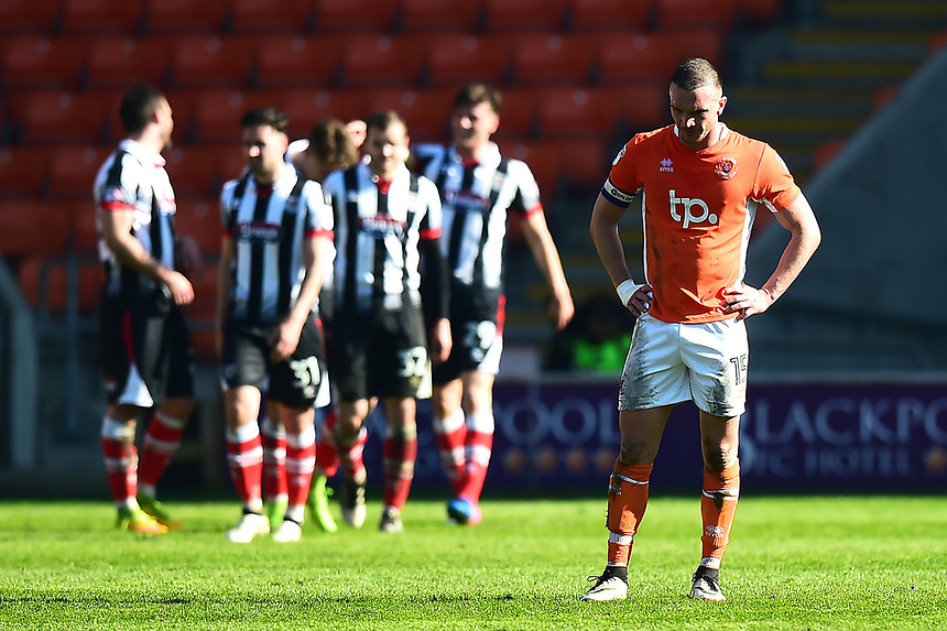 Blackpool's Tom Aldred reacts after Grimsby scored their third goal<br /> <br /> Photographer Richard Martin-Roberts/CameraSport<br /> <br /> The EFL Sky Bet League Two - Blackpool v Grimsby Town - Saturday 8th April 2017 - Bloomfield Road - Blackpool<br /> <br /> World Copyright &copy; 2017 CameraSport. All rights reserved. 43 Linden Ave. Countesthorpe. Leicester. England. LE8 5PG - Tel: +44 (0) 116 277 4147 - admin@camerasport.com - www.camerasport.com