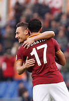 Calcio, Serie A: Roma-Genoa. Roma, stadio Olimpico, 12 gennaio 2014.<br /> AS Roma defender Mehdi Benatia, of Morocco, right, celebrates with teammate Francesco Totti after scoring during the Italian Serie A football match between AS Roma and Genoa, at Rome's Olympic stadium, 12 January 2014. <br /> UPDATE IMAGES PRESS/Isabella Bonotto