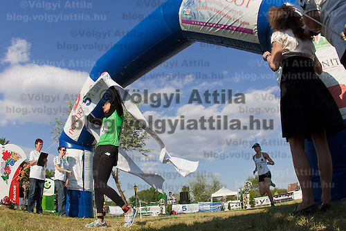 Egypt's Aya Medani (2nd R) crosses the finish line first ahead of Germany's Lena Schoneborn (R) during the Modern Pentathlon Women's World Cup held in Budapest, Hungary on May 07, 2011. ATTILA VOLGYI