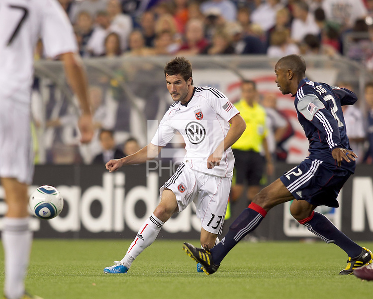 DC United forward Chris Pontius (13) passes the ball as New England Revolution defender Cory Gibbs (12) defends. The New England Revolution defeated DC United, 1-0, at Gillette Stadium on August 7, 2010.