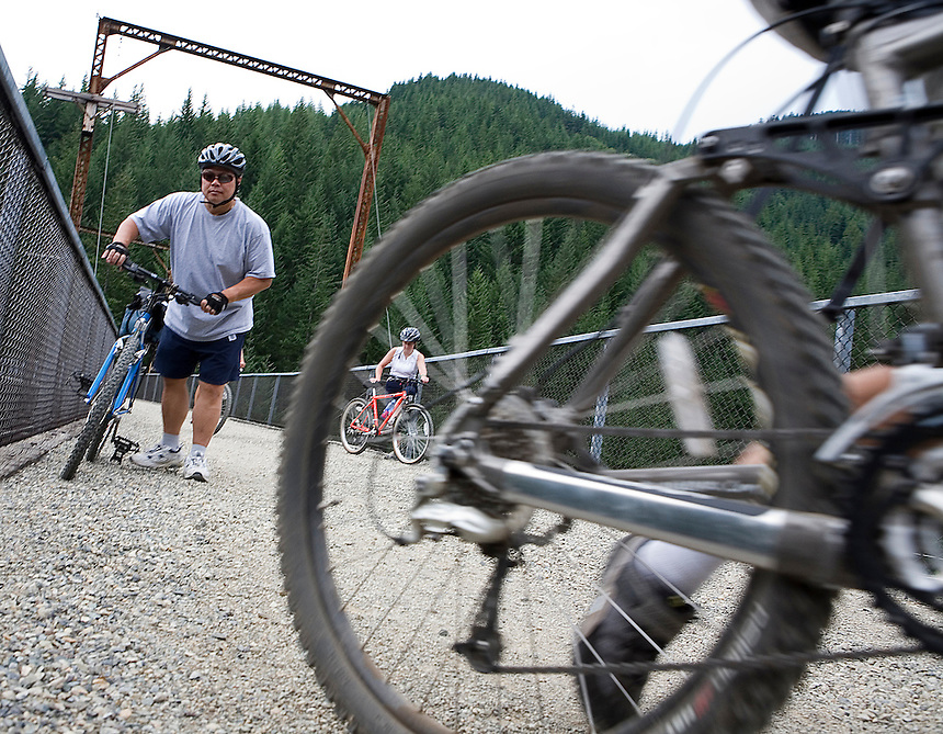 Photo by Stephen Brashear.Richard Chou of Kirkland, Wash., prepares to get back on his mountain bike after checking out view from a trestle along the John Wayne Pioneer Trail between Hyak, Wash., and Rattlesnake Lake near North Bend, Wash. Sunday Aug. 17, 2008.