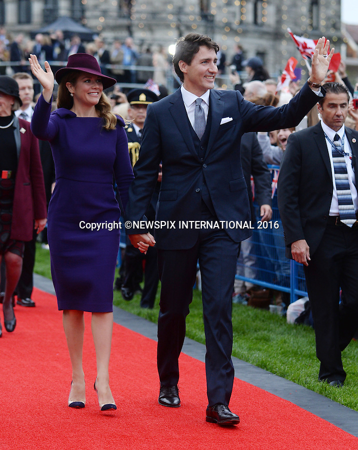 UK - 28 Days Out<br /> 24.09.2016; Victoria, Canada: CANADIAN PREMIER JUSTIN TRUDEAU AND WIFE SOPHIE<br /> at the official ceremony to welcome them held at the British Columbia Parliament Buildings, Victoria<br /> The tour will take Royals to parts of both British Columbia and the Yukon.<br /> Mandatory Photo Credit: &copy;NEWSPIX INTERNATIONAL<br /> <br /> IMMEDIATE CONFIRMATION OF USAGE REQUIRED:<br /> Newspix International, 31 Chinnery Hill, Bishop's Stortford, ENGLAND CM23 3PS<br /> Tel:+441279 324672  ; Fax: +441279656877<br /> Mobile:  07775681153<br /> e-mail: info@newspixinternational.co.uk<br /> Usage Implies Acceptance of OUr Terms &amp; Conditions<br /> Please refer to usage terms. All Fees Payable To Newspix International