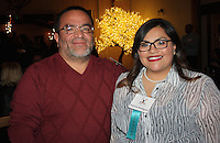 NWA Democrat-Gazette/CARIN SCHOPPMEYER Patricia Rodriguez, Single Parent Scholarship Fund of NWA scholar, is joined by her father Manuel Rodriguez at Jingle Mingle on Dec. 1.