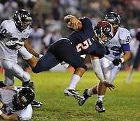 Cypress Nick Buras gets airborne as he picks up yardage against Pacifica in an Empire League game at Western<br />