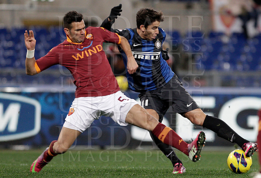 Calcio, semifinale di andata di Coppa Italia: Roma vs Inter. Roma, stadio Olimpico, 23 gennaio 2013..FC Inter midfielder Gabriel Ricardo Alvarez, of Argentina, is challenged by AS Roma defender Leandro Castan, of Brazil, left, during the Italy Cup football semifinal first half match between AS Roma and FC Inter at Rome's Olympic stadium, 23 January 2013..UPDATE IMAGES PRESS/Riccardo De Luca