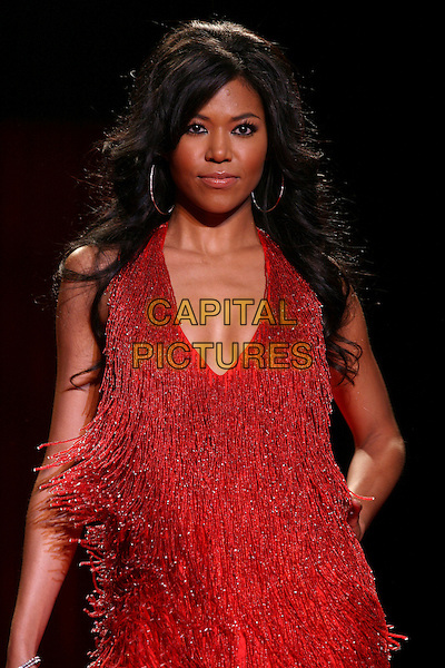 AMERIE.The Heart Truth Red Dress Collection Fashion Show .The Olympus Fashion Week,.New York, New York, USA,.3rd February 2006..half Length runway catwalk celebrity modelling tassles.Ref: IW .www.capitalpictures.com.sales@capitalpictures.com.©Capital Pictures