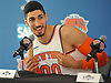 Enes Kanter #00 of the New York Knicks kiddingly gestures with his jersey as he speaks during the team's Media Day held at Madison Square Garden Training Center in Greenburgh, NY on Monday, Sept. 25, 2017.