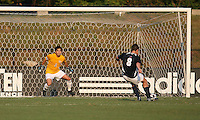 04 September 2009: Michael Thomas #8 of the University of Notre Dame beats Akira Fitzgerald #1 of Wake Forest University to score from the penalty spot during an Adidas Soccer Classic match at the University of Indiana in Bloomington, In. The game ended in a 1-1 tie..