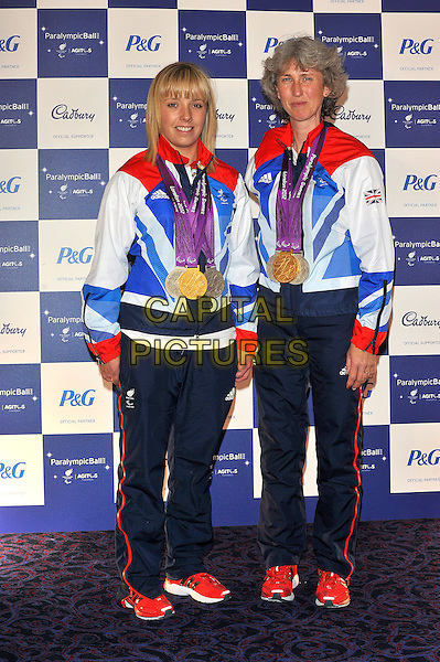 Deborah Criddle and Sophie Wells.The Paralympic Ball in aid of the British Paralympic Association & the Agitos Foundation, Grosvenor House Hotel, Park Lane, London, England..September 5th, 2012.full length athletes blue white red tracksuit .CAP/CJ.©Chris Joseph/Capital Pictures.