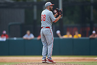 North Carolina State Wolfpack starting pitcher Brian Brown (38) looks to his catcher for the sign against the Northeastern Huskies at Doak Field at Dail Park on June 2, 2018 in Raleigh, North Carolina. The Wolfpack defeated the Huskies 9-2. (Brian Westerholt/Four Seam Images)