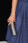WESTWOOD, CA- AUGUST 07: Actress Alice Braga (handbag, bracelet detail) at the Los Angeles premiere of 'Elysium' at Regency Village Theatre on August 7, 2013 in Westwood, California.