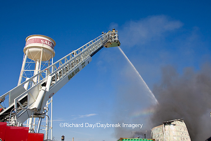 63818-022.08 Firefighters extinguishing warehouse fire using aerial ladder truck, Salem, IL